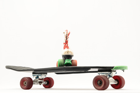 Vintage Style Black Skateboard on a white Background photo