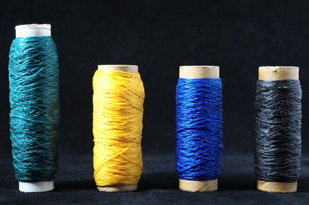 cable knit: Roll of Twine isolated on a Black Background