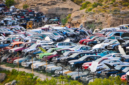 Scrap Yard With Pile Of Crushed Cars in tenerife canary islands spain photo
