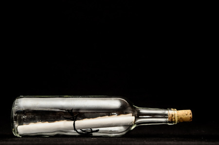 Message in bottle on a black background 스톡 콘텐츠