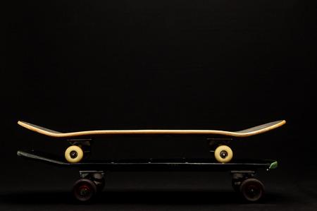 80 s: Vintage Style Black Skateboard on a Dark Background