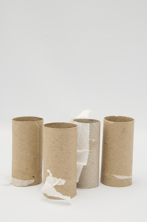 bog: Empty Toilet Rolls Stack Up On a Black Background