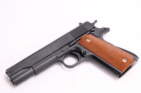 Black semi automatic Handgun on white background photo