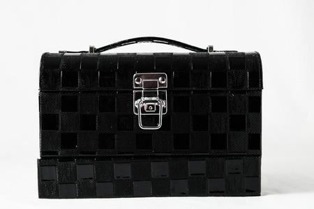 Black Makeup box isolated on white background photo