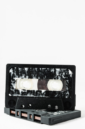 analogical: Ancient Vintage Used Musicassette over a White Background Stock Photo