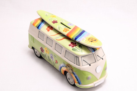 Van with a Surf Board on White Background photo