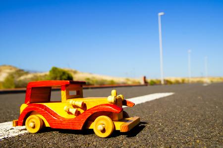 Transportatio Concept Toy Car on The Asphalt Street photo
