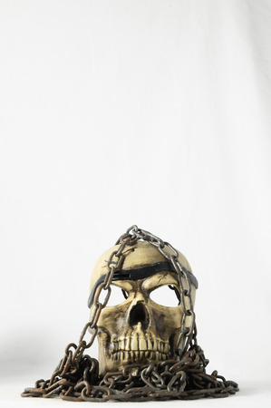 Skull and old Chains on a White Background photo