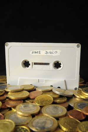 80 s: Money and Music Concept Tape Musicassette and Coins Stock Photo
