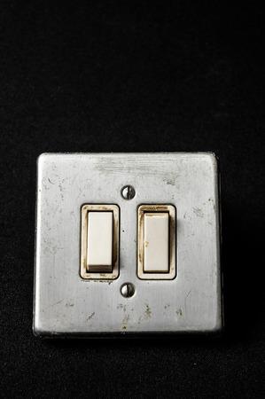 Light switch, old-style on a Black Background photo