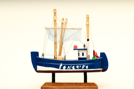 Beautiful miniature ship  Wooden sailship figurine  Antique model sailing boat isolated on white photo