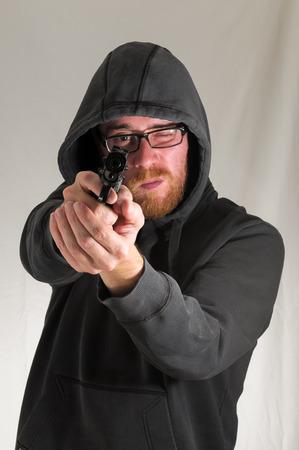 Black Dressed Young Man Holding a Pistol Gun