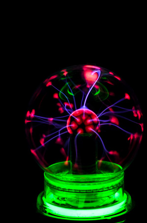 Tesla Plasma Static Electricity sphere on a black background photo
