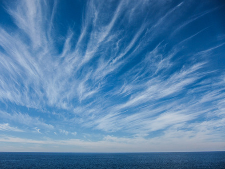 Wndy Clouds On The Evening Atlantic Ocean Sky Stock Photo