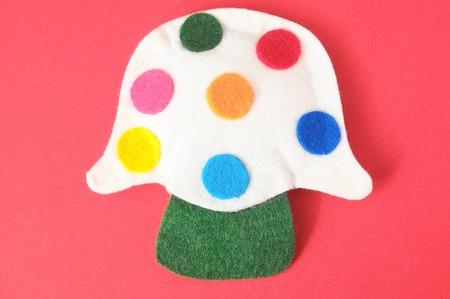 fairy toadstool: Cloth Multicolored Magic Mushroom on a Colored Background