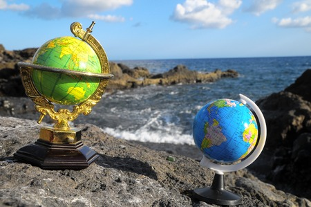 Ancient Vintage Globes Planet Earth near the Atlantic Ocean photo
