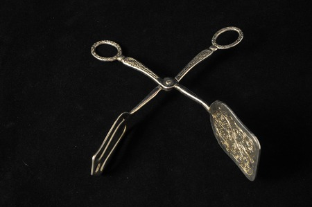 Ancient Vintage Silver Flatware on a Black Background