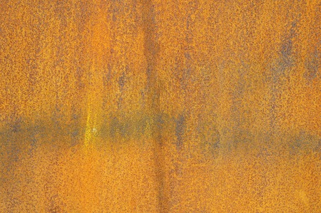 Orange Patterns on the Rusty Surface of the Metal photo