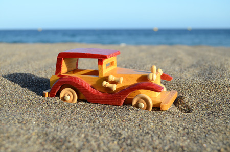 Toy car on Sand Beach Trasportation Concept photo
