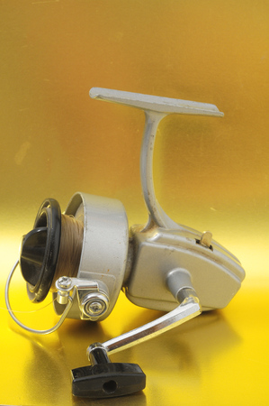 One Vintage Old Fishing Reel on a Colored Background Stock Photo - 28167148