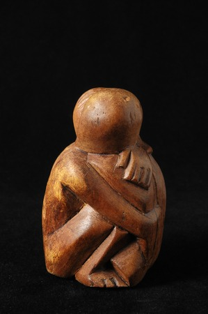 Lovers Sculpture made of Wood on a Black Background photo