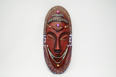 Wooden African Mask on a White Background Stock Photo