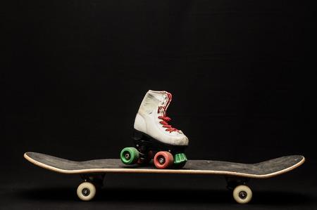 70 s: Vintage Style Black Skateboard and Skate Boot on a Dark Background