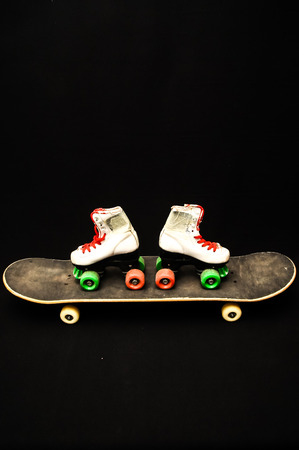 80 s: Vintage Style Black Skateboard and Skate Boot on a Dark Background
