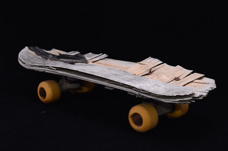 Vintage Style Concued Skateboard on a Black Background photo