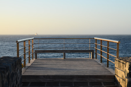 Sunrise on a Pier over Atlantic Ocean in Tenerife Canary Islands Spain photo