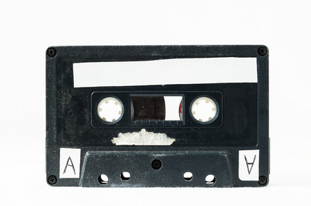 Ancient Vintage Used Musicassette over a White Background photo