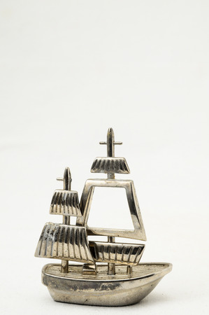 Metal Sailing Boat Figurine on a white background photo