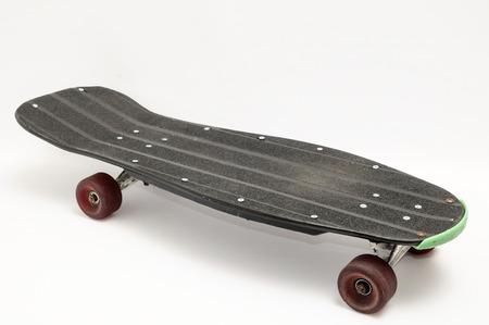 80 s: Vintage Style Black Skateboard on a white Background Stock Photo