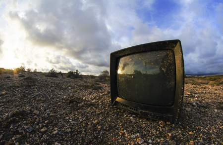 Abandoned Broken Television in the Desert on a Cloudy Day photo