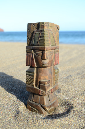 Ancient Maya Statue on the Sand Beach near the Ocean Stock Photo