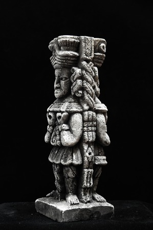 pre columbian: One Ancient Mayan Statue on a Black Background