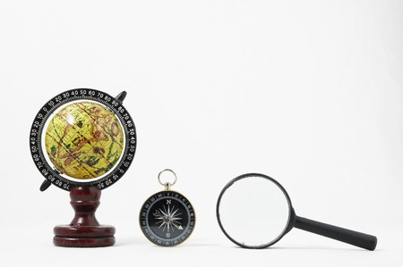 Vintage Tools Globe Compass and Loupe on a White Background photo