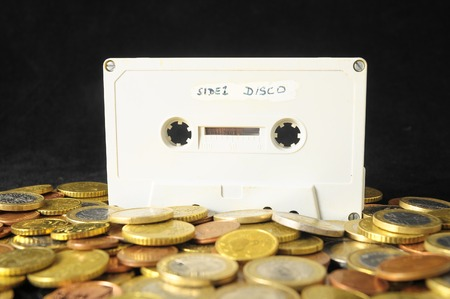 Money and Music Concept Tape Musicassette and Coins Stock Photo