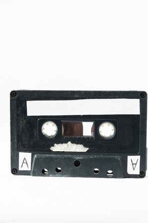 80 s: Ancient Vintage Used Musicassette over a White Background Stock Photo