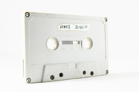 tape cassette: Ancient Vintage Used Musicassette over a White Background Stock Photo