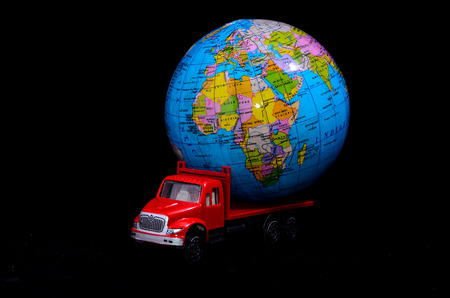 Truck With Earth Globe Delivery Transportation Concept photo