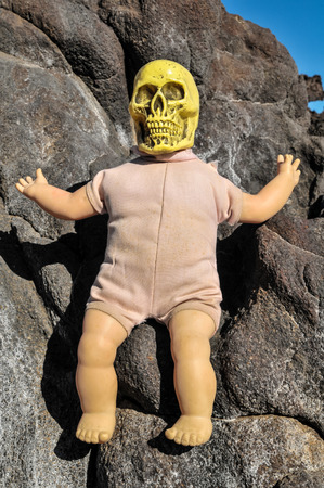 Ancient Vintage Old Doll with Human Skull Head photo