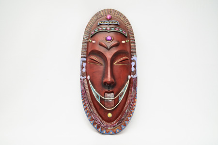 Wooden African Mask on a White Background photo