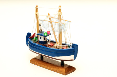 Beautiful miniature ship  Wooden sailship figurine  Antique model sailing boat isolated on white photo