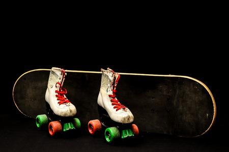 Vintage Style Black Skateboard and Skate Boot on a Dark Background