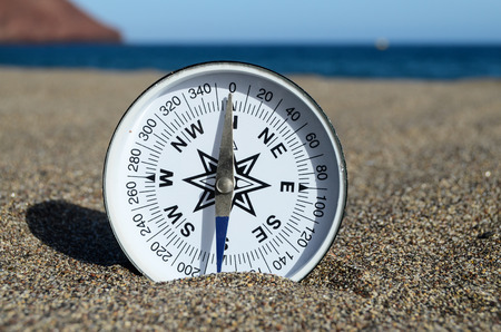 Orientation Concept One Compass on the Beach near the Atlantic Ocean