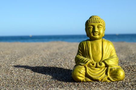 One Ancient Buddha Statue Near The Ocean photo
