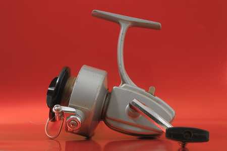 One Vintage Old Fishing Reel on a Colored Background Stock Photo - 28749314