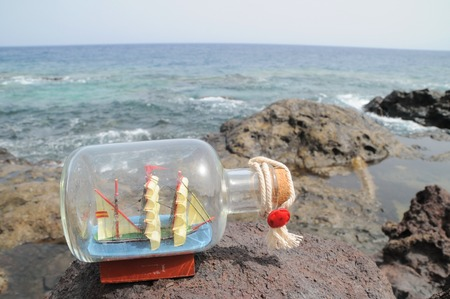 Sailing Ship in the Bottle near the Ocean photo