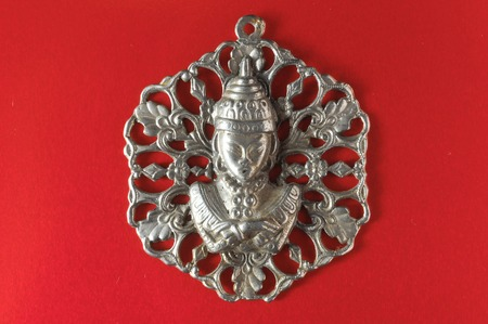 Silver Buddha Pendant Jewel over a Colored Background photo